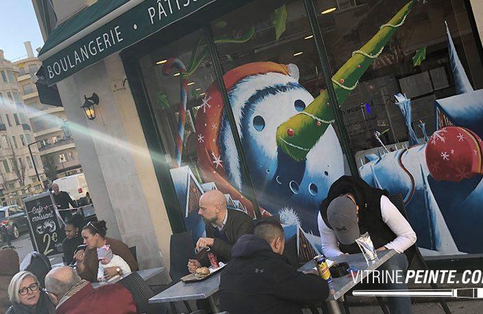 idée décoration vitrine boulangerie Noël bonhome de neige